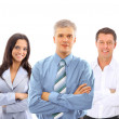 Confident young business executive with his team in the background — Stock Photo #5261656