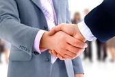 Handshake isolated over business background — Stock Photo