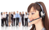Woman wearing headset in office; could be receptionist — Stock Photo
