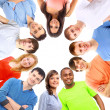 low angle view of happy men and women standing together in einem kreis — Stockfoto #5302515