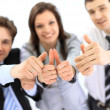 Group of business giving thumbs up — Stockfoto
