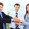 Image of business hands on top of each other symbolizing support and - Stock Photo