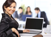 Business woman with team working on laptop — Stockfoto