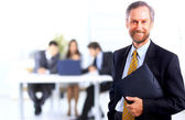 Portrait of successful businessman and business team at office — Stock Photo