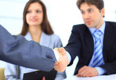 Two Business men shaking hands while team smiling at office — Stock Photo