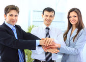 Image of business hands on top of each other symbolizing support and — Stock Photo