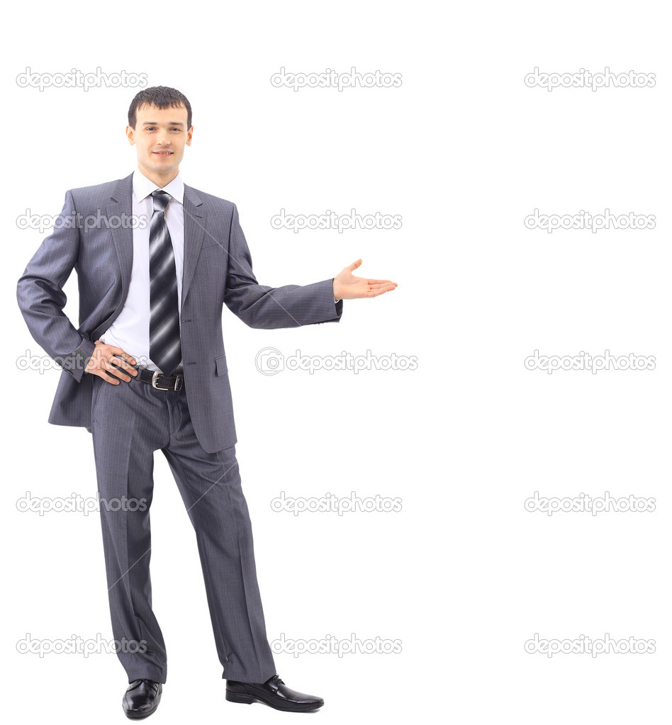 A portrait of a young businessman holding his arm out presenting something  — Stock Photo #5302815