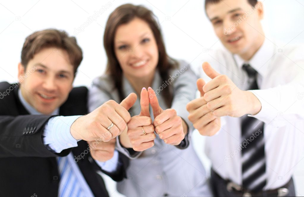 Group of business giving thumbs up — Stock Photo #5303431