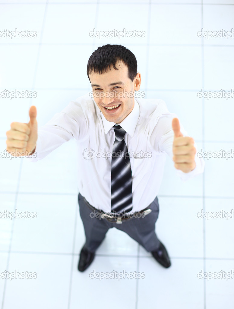 Happy businessman standing outside with arms outstretched  — Stock Photo #5303518