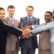 A diverse group of business workers with their hands together in form of te - Stock Photo