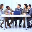 Stock Photo: Leader with his successful team discussing in conference room