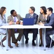 Leader with his successful team discussing in conference room — Stock Photo #5350987