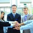 Handshake and teamwork — Stockfoto