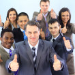 Stock Photo: Business approval - Portrait of confident young colleagues with thumbs up s