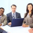 Group of happy business colleague in a meeting together at office — Stock Photo #5353895