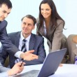 Multi ethnic business executives at meeting discussing work — Stockfoto #5353917