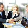 Business shaking hands, finishing up a meeting - Stockfoto