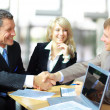 Foto Stock: Business shaking hands, finishing up meeting
