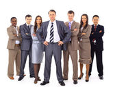 Confident business executive with his team in the background — Stock Photo