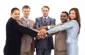 A diverse group of business workers with their hands together in form of te — Stock Photo