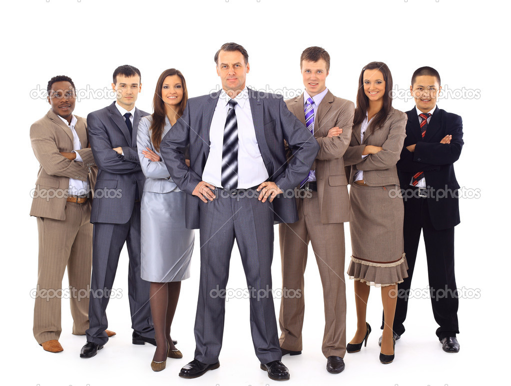 Confident business executive with his team in the background   Stock Photo #5350829