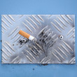 Cigarette End on Cigarette Stubbing Plate - Stock Photo