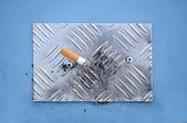 Cigarette End on Cigarette Stubbing Plate — Stock Photo