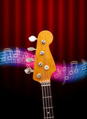 Bass Guitar Head And Music Notes — Stock Photo