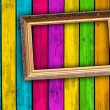 Photo: Blank Frame on Multicolored Wood Background