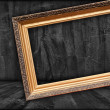 Blank Picture Frame in Dark Room — Stock Photo #5235866
