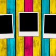 Three Blank Photos on Multicolored Wood Background — Stock Photo