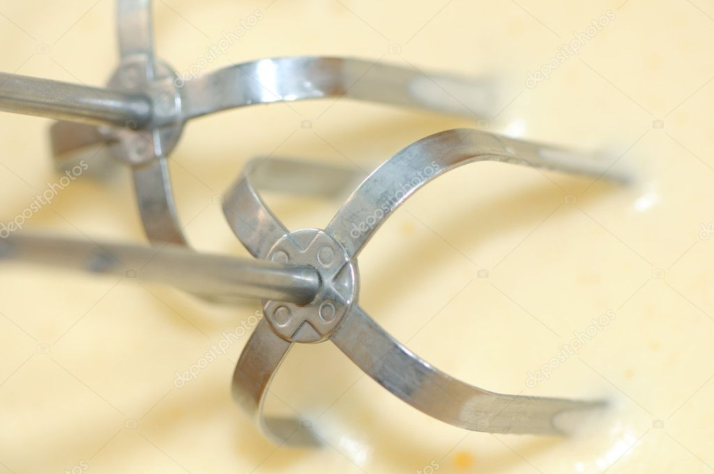 A close-up of an electric egg beater in beaten eggs — Stock Photo #5377230