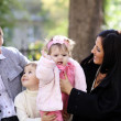 Family in autumn park — Stock Photo #4084020