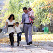 Family in autumn park — Stock Photo #4084323