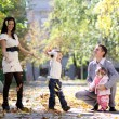 Family in autumn park — Stockfoto #4084777
