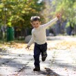 Little boy runs in a summer park — Stock Photo