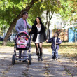 Family in autumn park — Stock Photo #4084809