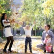 Family in autumn park — Stock Photo #4084841