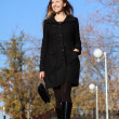 Full length, walking woman in autumn park — Stock Photo #4089974