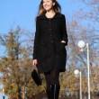 Full length, walking woman in autumn park — Stock Photo