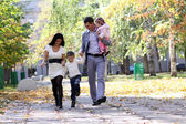 Family in autumn park — Photo