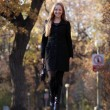 Full length, walking woman in autumn park — 图库照片