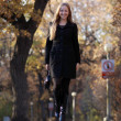 Full length, walking woman in autumn park — Foto de Stock