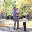 Family in autumn park — Stock Photo #4493475