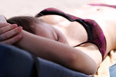 Young woman sunbathes lying on chaise lounges — Stock Photo