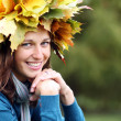 Beautiful woman with diadem made from yellow maple leaves - Photo