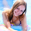 Portrait of a beautiful happy woman in swimming pool - ストック写真