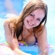Portrait of a beautiful happy woman in swimming pool - Foto de Stock