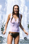 Attractive girl bathing in city fountain — Photo