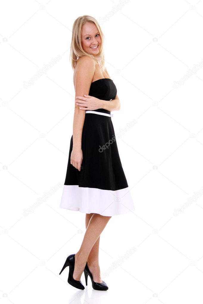 Full length of a beautiful young lady in  dress standing against isolated white background  — Stock Photo #5122593